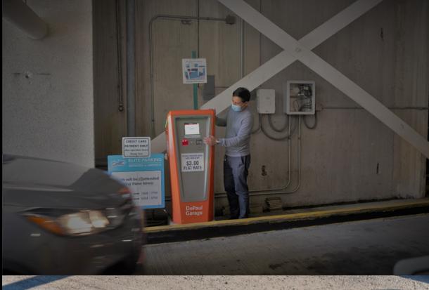 Image of elite employee monitoring proactive equipment